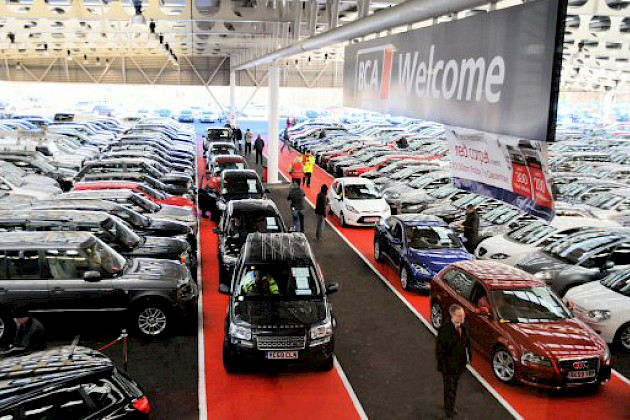The show floor of a car auction