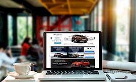 An online car sales website displayed on a laptop